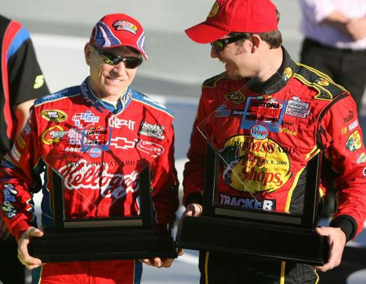 Mark Martin, left, and Martin Truex Jr. stand in Victory Lane together after winning the pole positions for the Daytona 500.