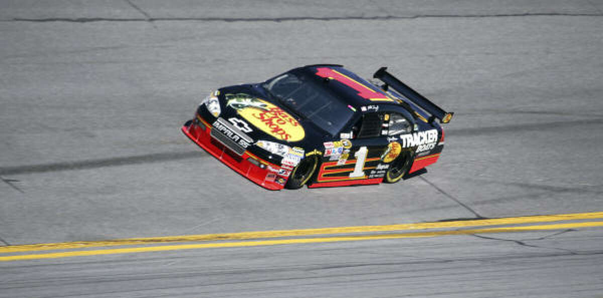 Martin Truex Jr. drives during qualifying. Truex won the pole position. Mark Martin took second place.
