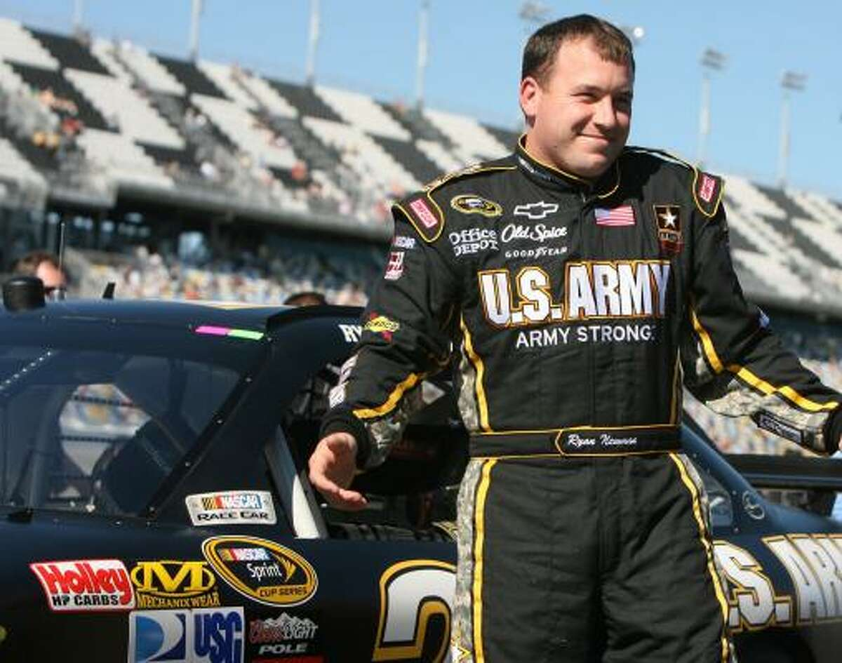 Ryan Newman, driver of the No. 39 U.S. ARMY Chevrolet, gets out of his car after securing the third fastest time with a speed of 187.778 during Daytona 500 pole qualifying.
