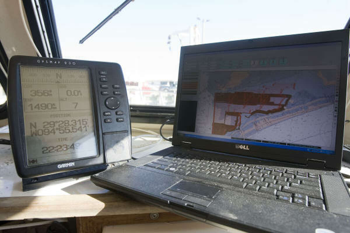 A GPS, left, and laptop will be used by officials to help find and remove the underwater debris.