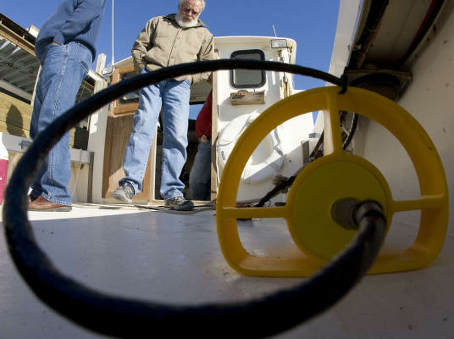 Chuck Pinson, of Crowder-Gulf, walks past a side scan sonar system that will search for underwater Ike debris. Photo: James Nielsen, Chronicle