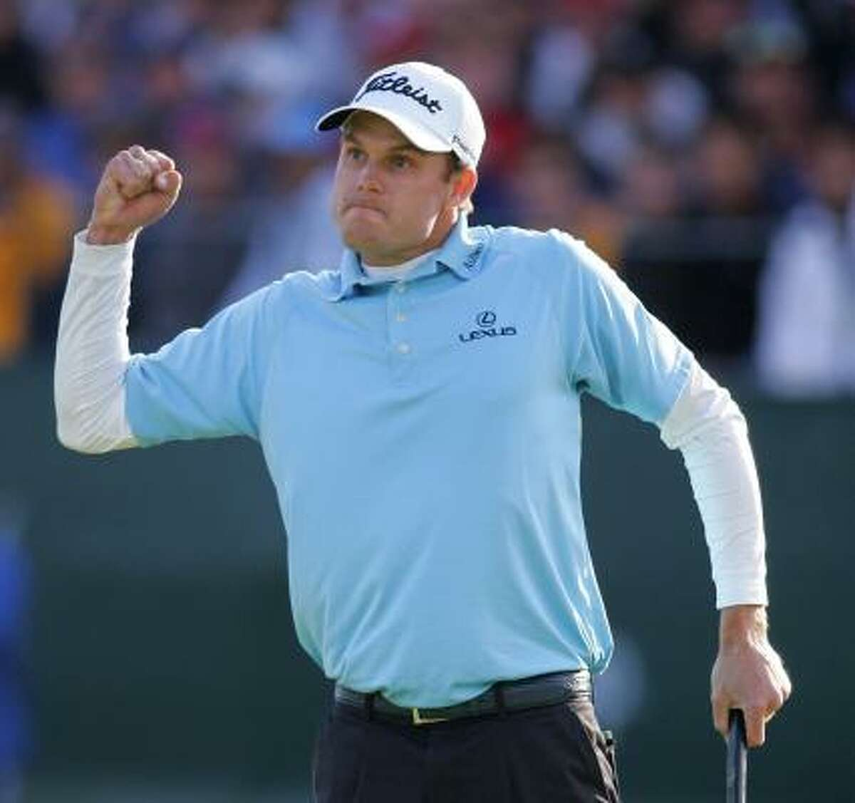 Nick Watney celebrates his victory after making birdie on the 18th hole for a one-shot victory at the Buick Invitational.