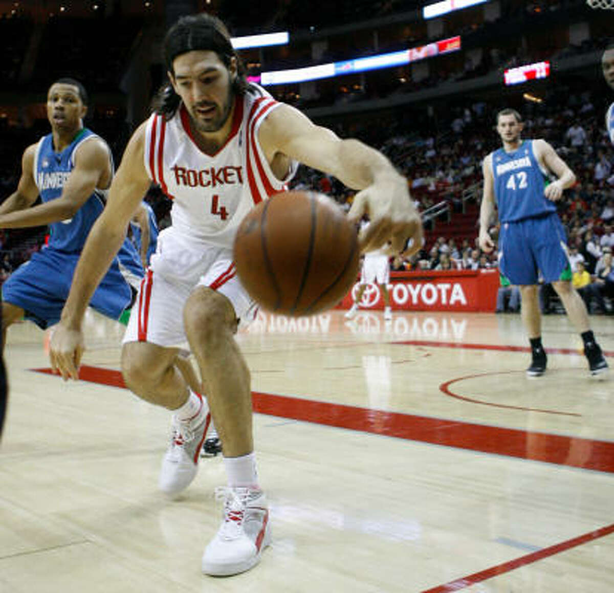 Luis Scola tries to keep the ball from rolling out of bounds in the first quarter.