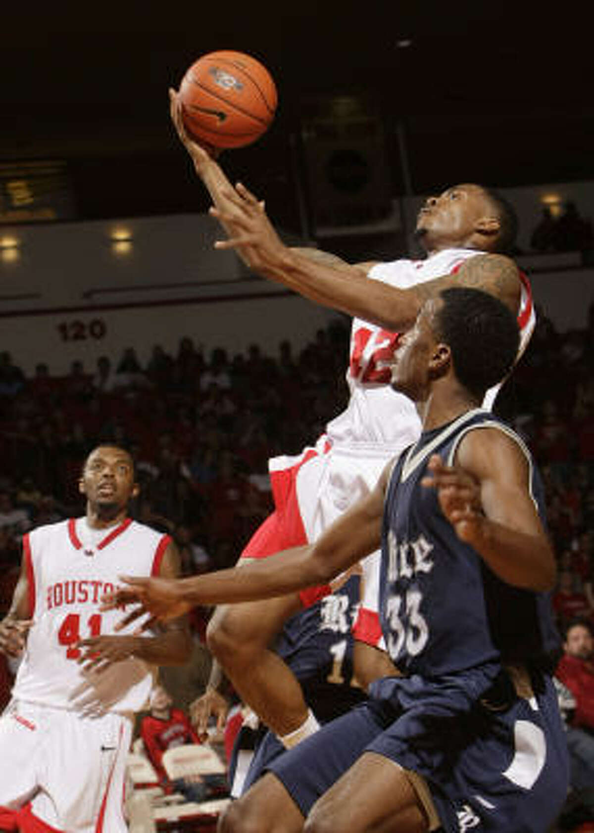 Aubrey Coleman (center) scored 27 points and grabbed 12 rebounds to lead UH to a 72-65 win over Rice on Saturday night at Hofheinz Pavilion.