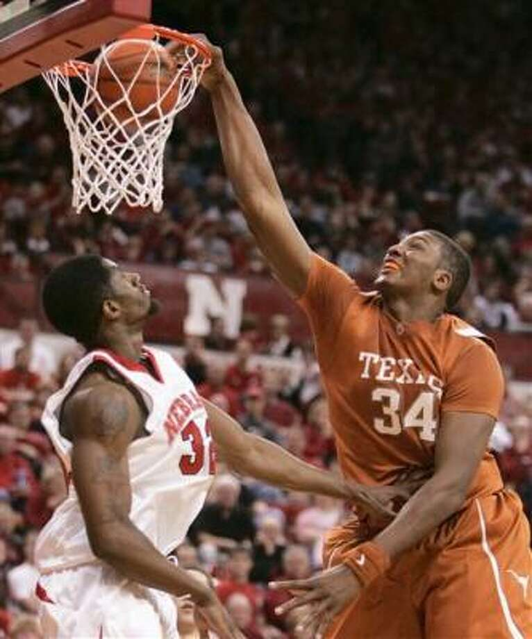 Texas' Dexter Pittman dunks over Nebraska's Chris Balham. Pittman finished with seven points as the Longhorns fell 58-55 in Lincoln, Neb. Photo: Nati Harnik, AP