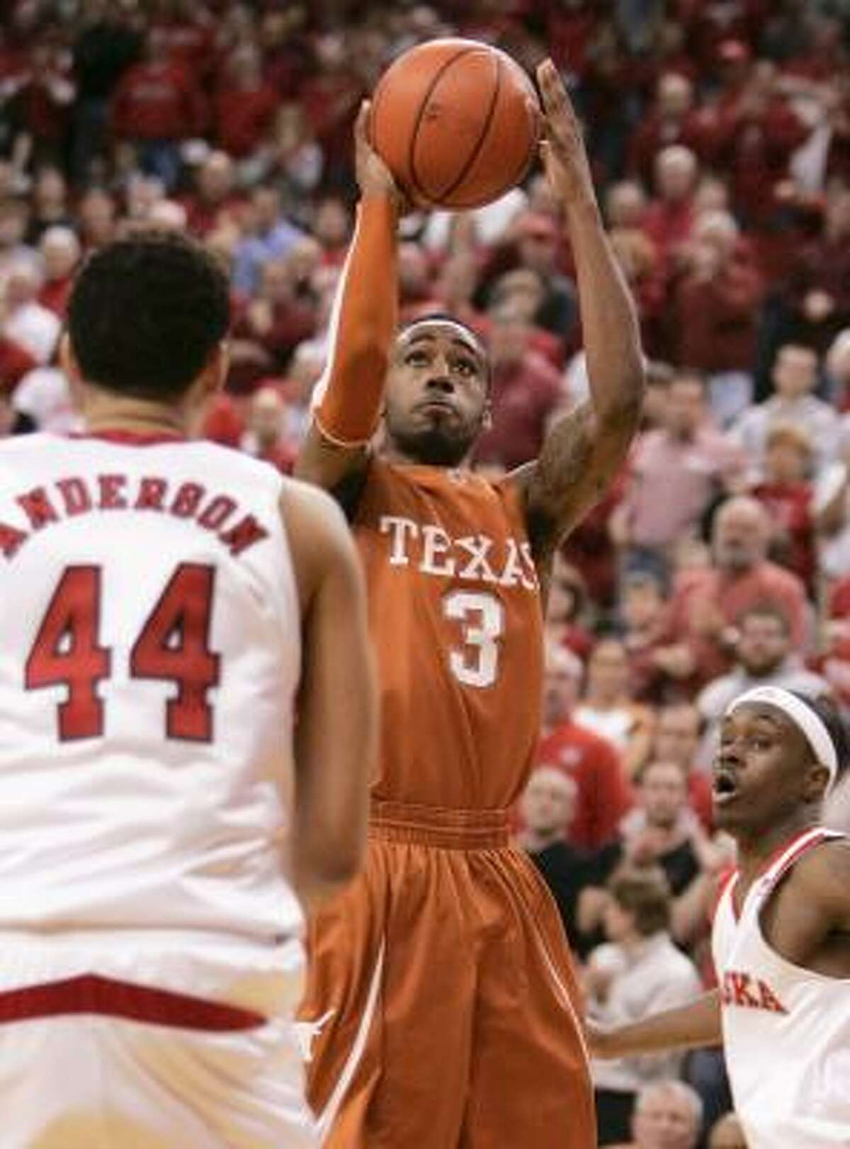 Texas' A.J. Abrams shoots one of his eight 3-pointers. He made four of them.