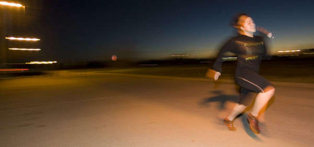 Marine recruit Dani Nguyen runs behind the Marine Corps recruiting office to prepare for basic training.