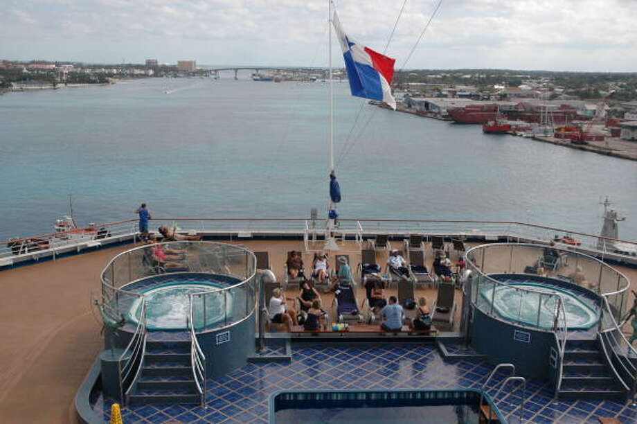 Passengers on the Carnival Splendor can relax in two hot tubs at the back of the ship. The Splendor is docked in Nassau on this day. Photo: Harry Shattuck, HOUSTON CHRONICLE