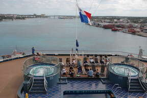 Passengers on the Carnival Splendor can relax in two hot tubs at the back of the ship. The Splendor is docked in Nassau on this day.