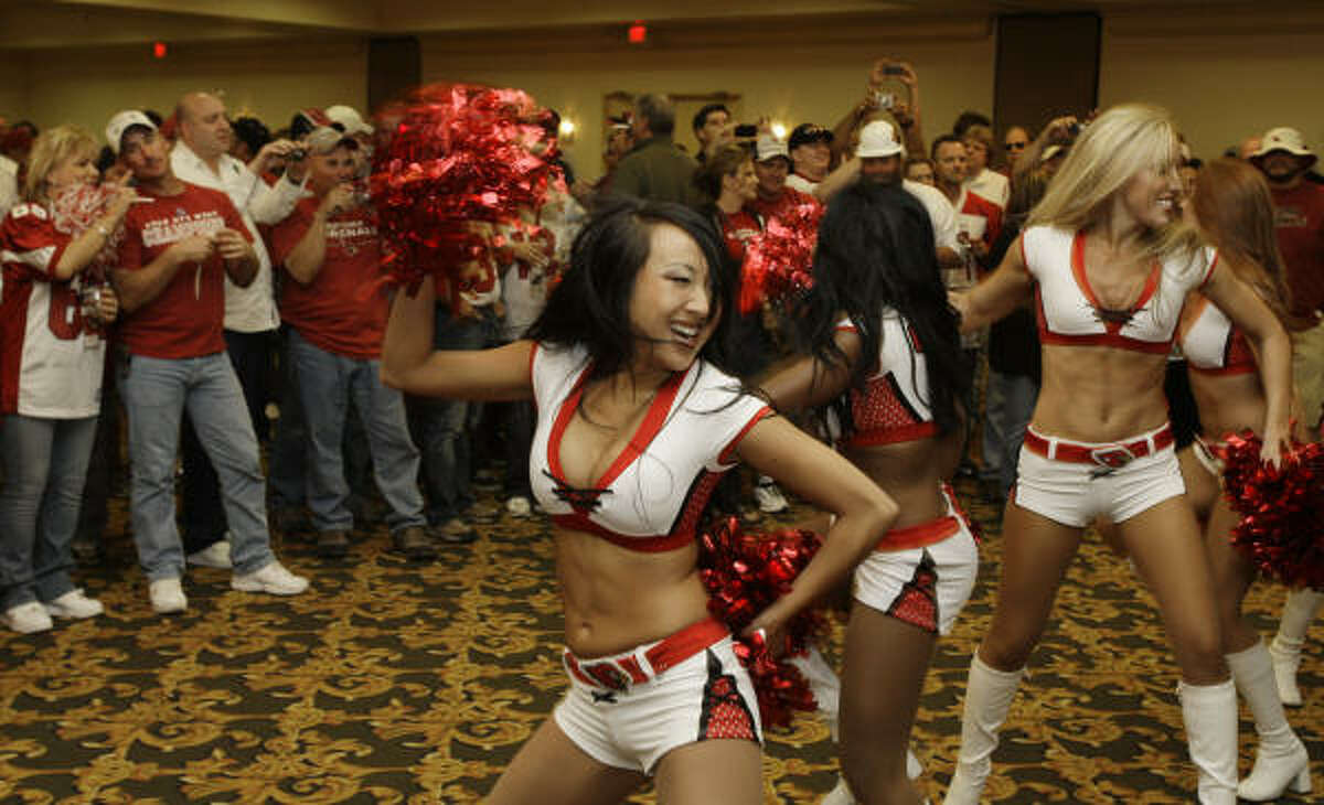 Arizona Cardinals cheerleaders perform for Cardinals fans at a pep rally in Tampa, Fla., the day before the Super Bowl.