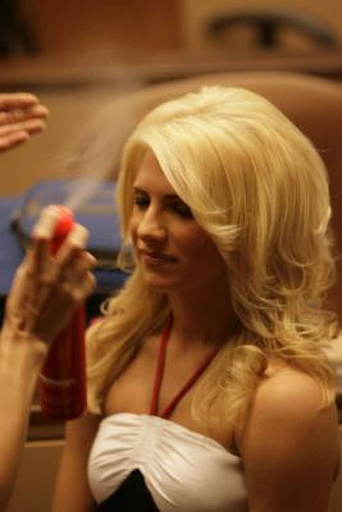 Candice, a Texans cheerleader, is hair-sprayed before her photo shoot for the Houston Texans Cheerleaders Swimsuit Calendar.
