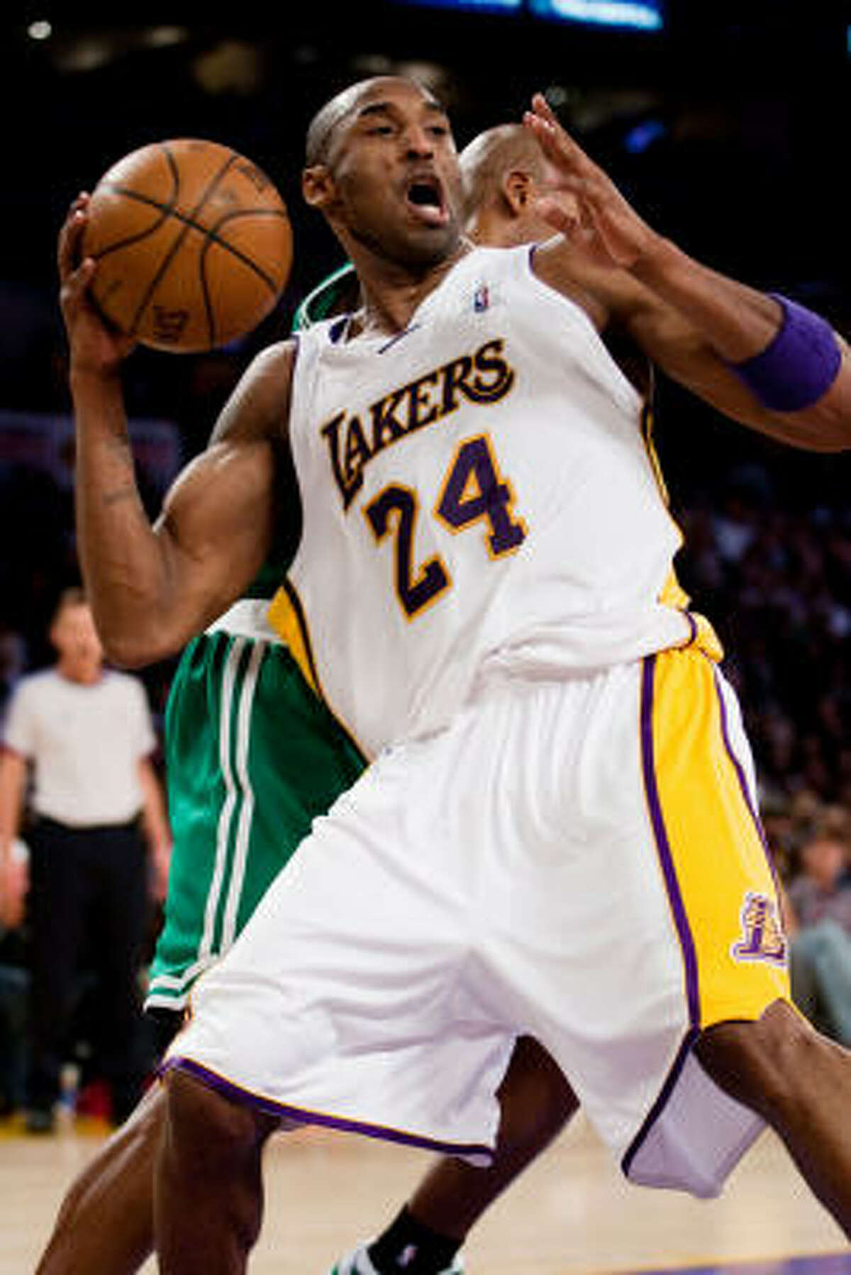 Kobe Bryant, seen here in the 2008 NBA finals against the Celtics, had 27 points to help Los Angeles beat Boston 92-83 in their first meeting this season, which came on Christmas Day.
