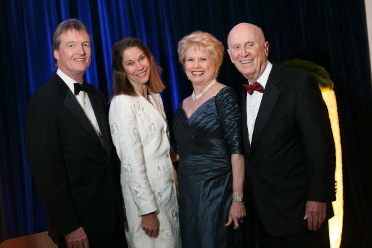 Bill Powers, from left, and wife Kim Heilbrun with Ginger and Jack Blanton at the Blanton Museum Gala.