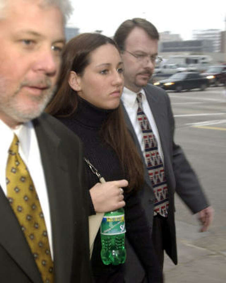 Lindsey Harris, shown with attorney John Davis, left, and her stepfather, James Shank, in 2003, was in the car with Harris  when the dentist ran over the teenager's father. Photo: Smiley N. Pool, Chronicle