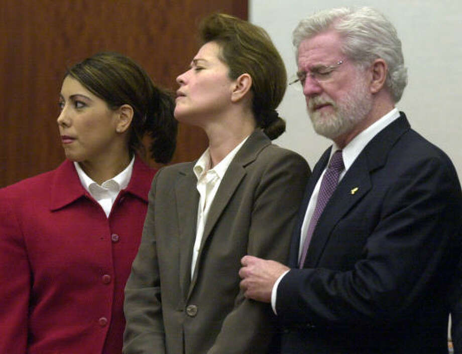 Clara Harris, flanked by her attorneys Emily Munoz and George Parnham, gets emotional after learning her fate in court in February 2004. Photo: Pat Sullivan, Associated Press