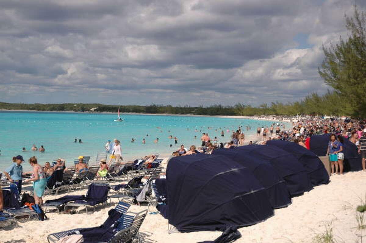 Passengers lounge on the beach, swim or enjoy watersports adventures.