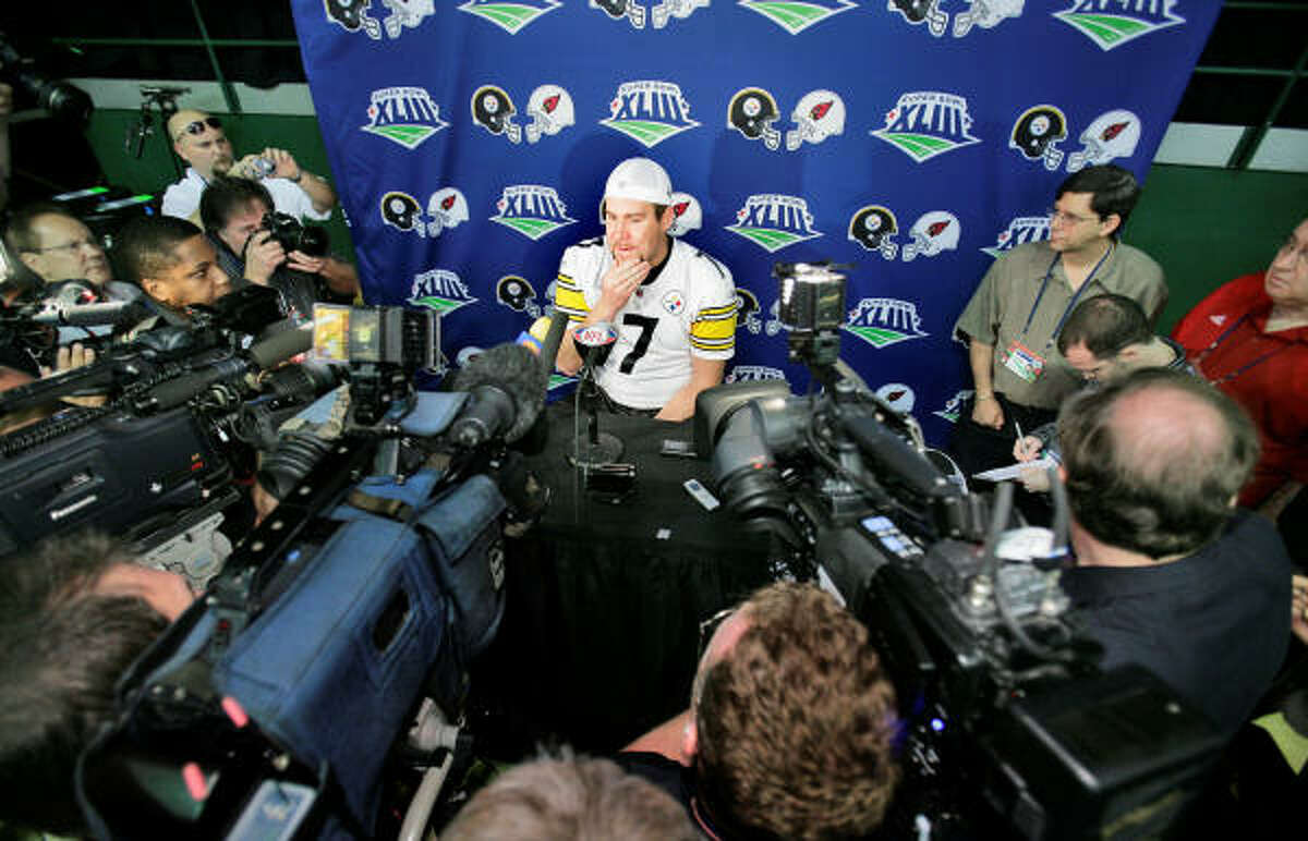 Pittsburgh Steelers quarterback Ben Roethlisberger is surrounded by the media as he answers questions.