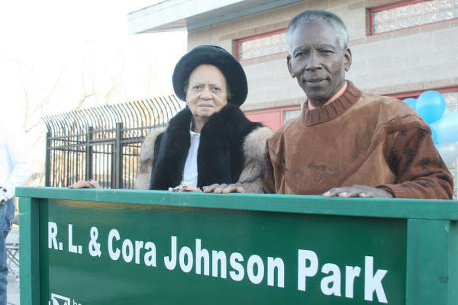CARVERDALE RENAMED:Cora and R.L. Johnson pose for a photo next to the new sign for the park. Photo: Pin Lim, For The Chronicle