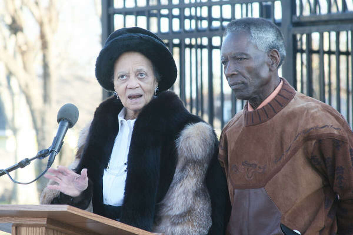 Cora and R.L Johnson speak to the gathered community members.
