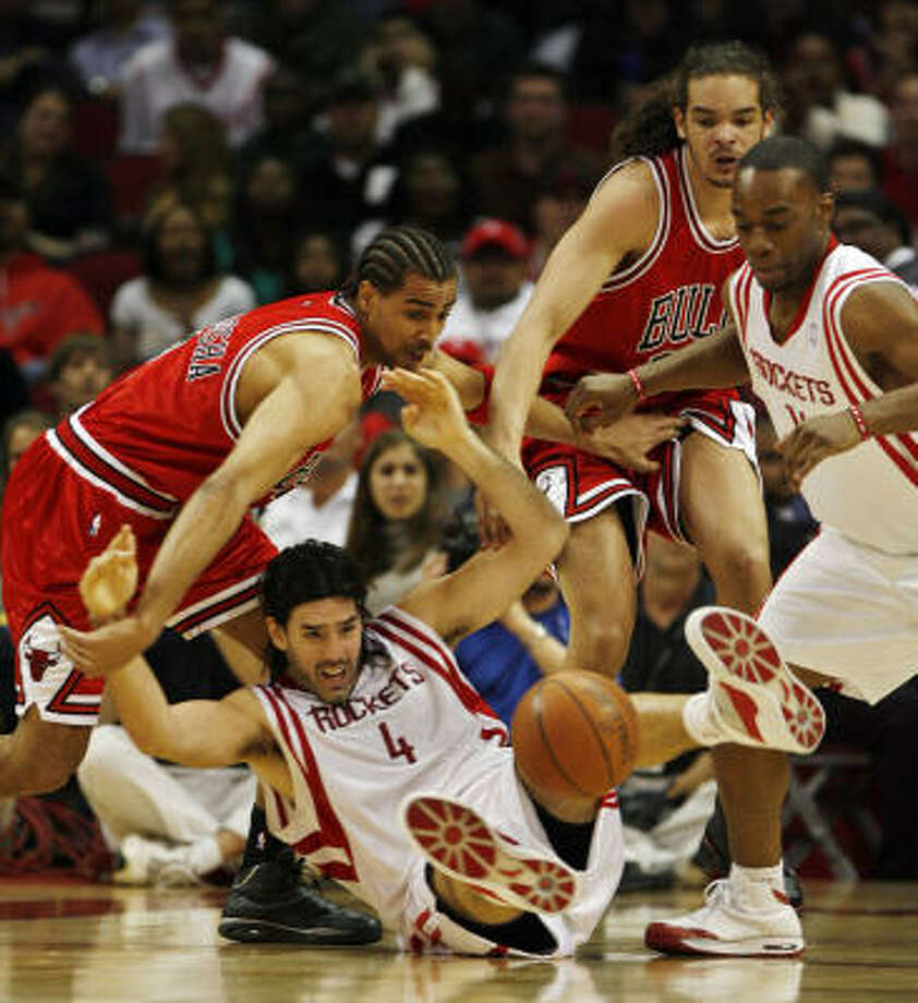 Luis Scola (4) and Carl Landry battle Chicago's Thabo Sefolsha (2) and Joakim Noah(13) for a loose ball in the second half. Photo: Eric Kayne, Chronicle