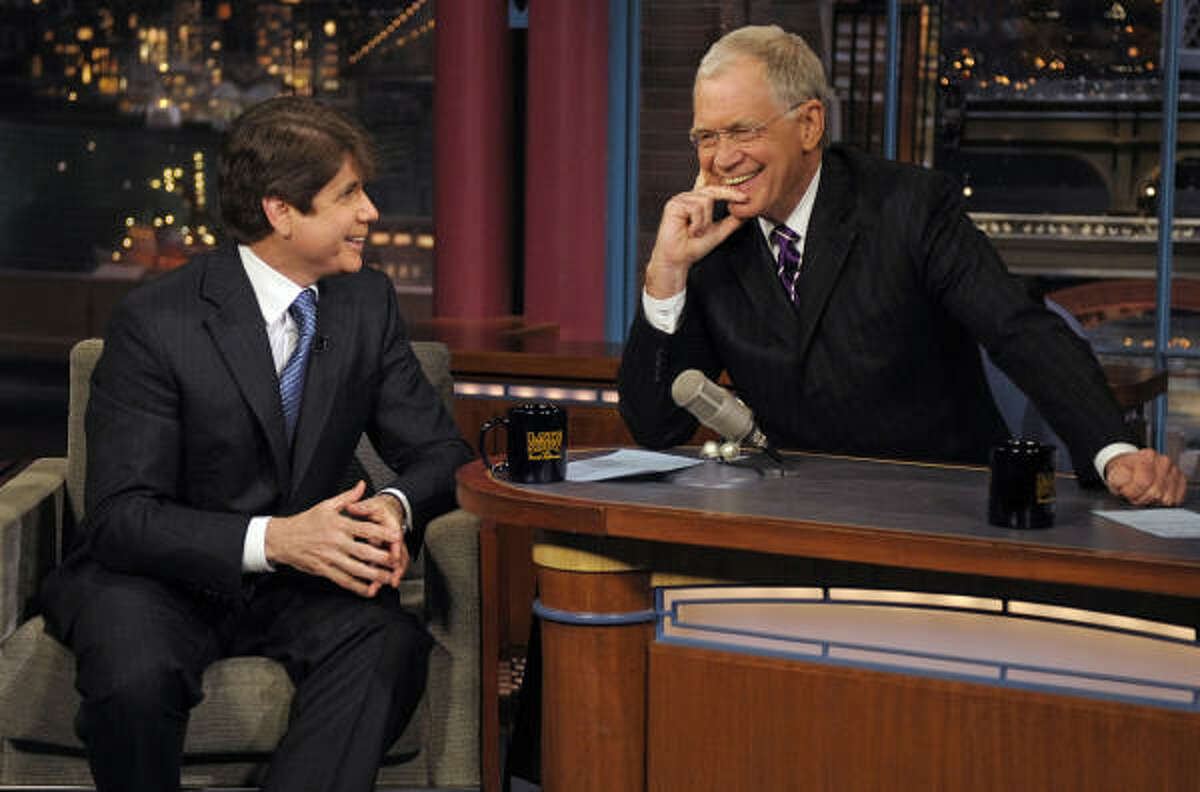 In this photo released by CBS, former Illinois Gov. Rod Blagojevich, left, shares a laugh with host David Letterman on the set of