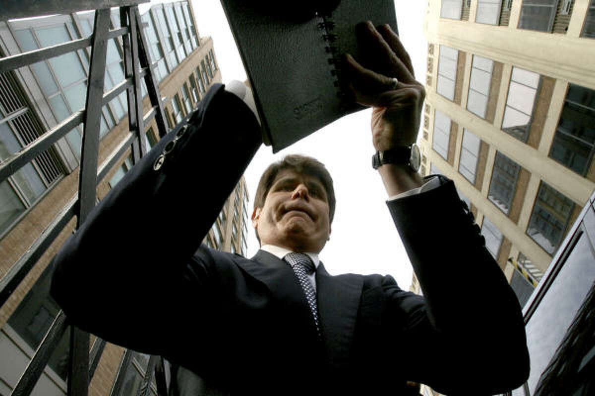 """Illinois Gov. Rod Blagojevich signs an autograph after making an appearance on the television program """"The View,"""" Monday, Jan. 26, 2009 in New York."""