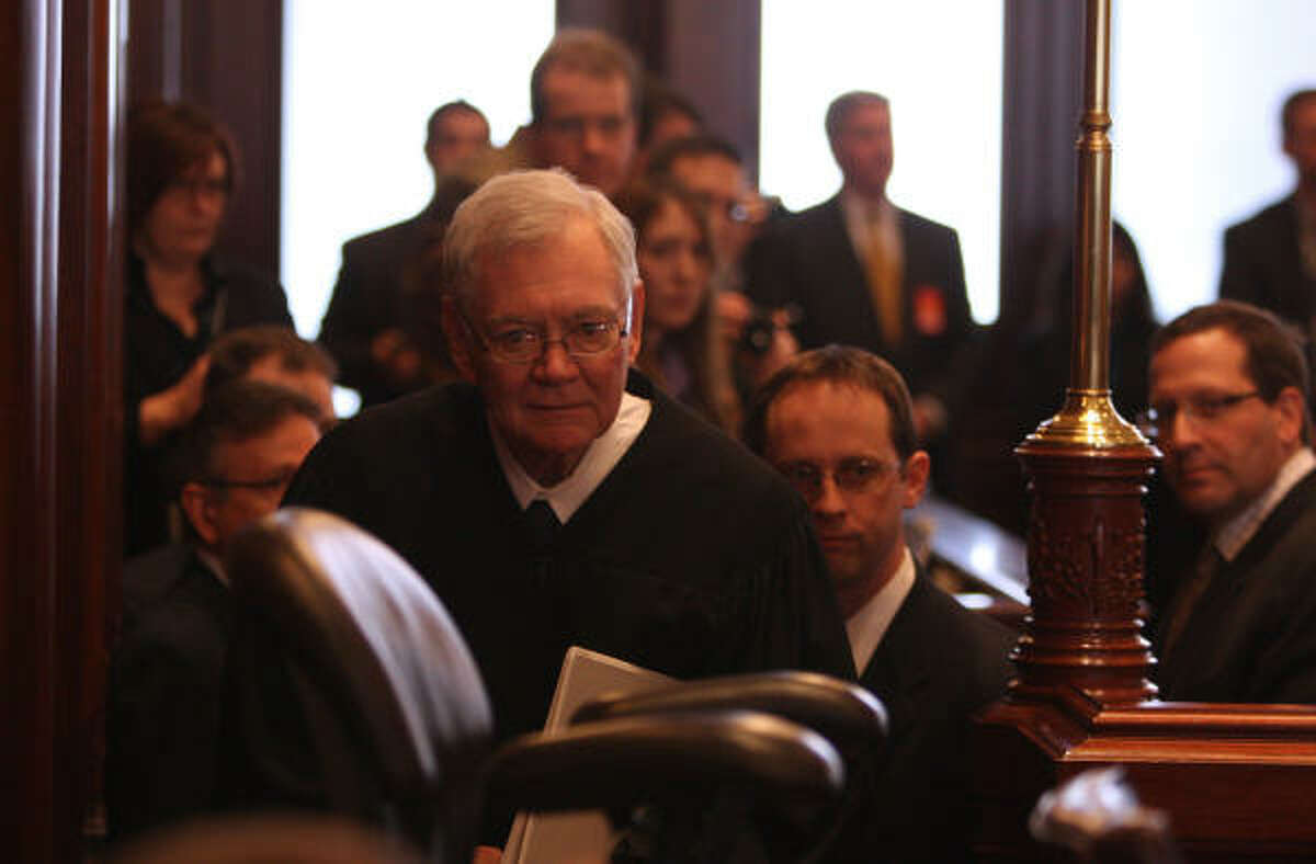 Chief Justice of the Illinois Supreme Court Thomas Fitzgerald, center, is escorted into the chamber before convening the first day of Gov. Rod Blagojevich's impeachment trial in the Illinois Senate Monday, January 26, 2009, in Springfield, Illinois.