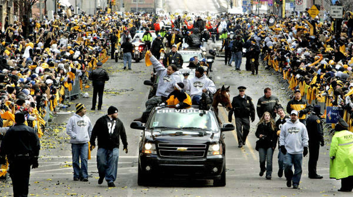 Pittsburgh Steelers safety Troy Polamalu, left, rides in a truck with teammates during their Super Bowl victory parade in Pittsburgh.