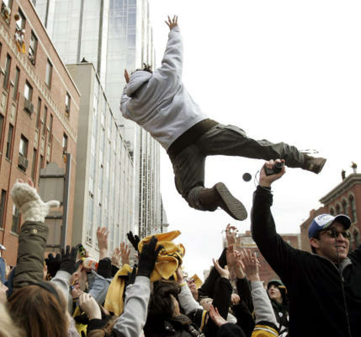 Pittsburgh Steelers safety Troy Polamalu leaps into the crowd during the Super Bowl victory parade.