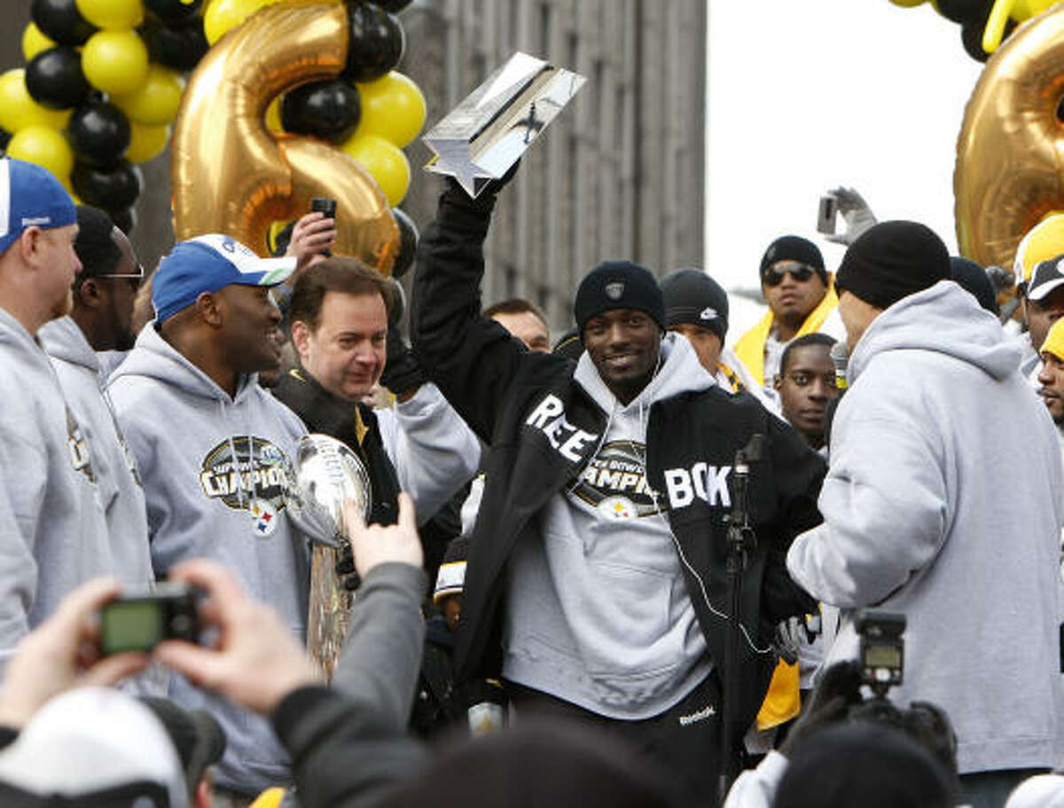 Wide receiver Santonio Holmes holds up the Super Bowl MVP trophy during the parade.