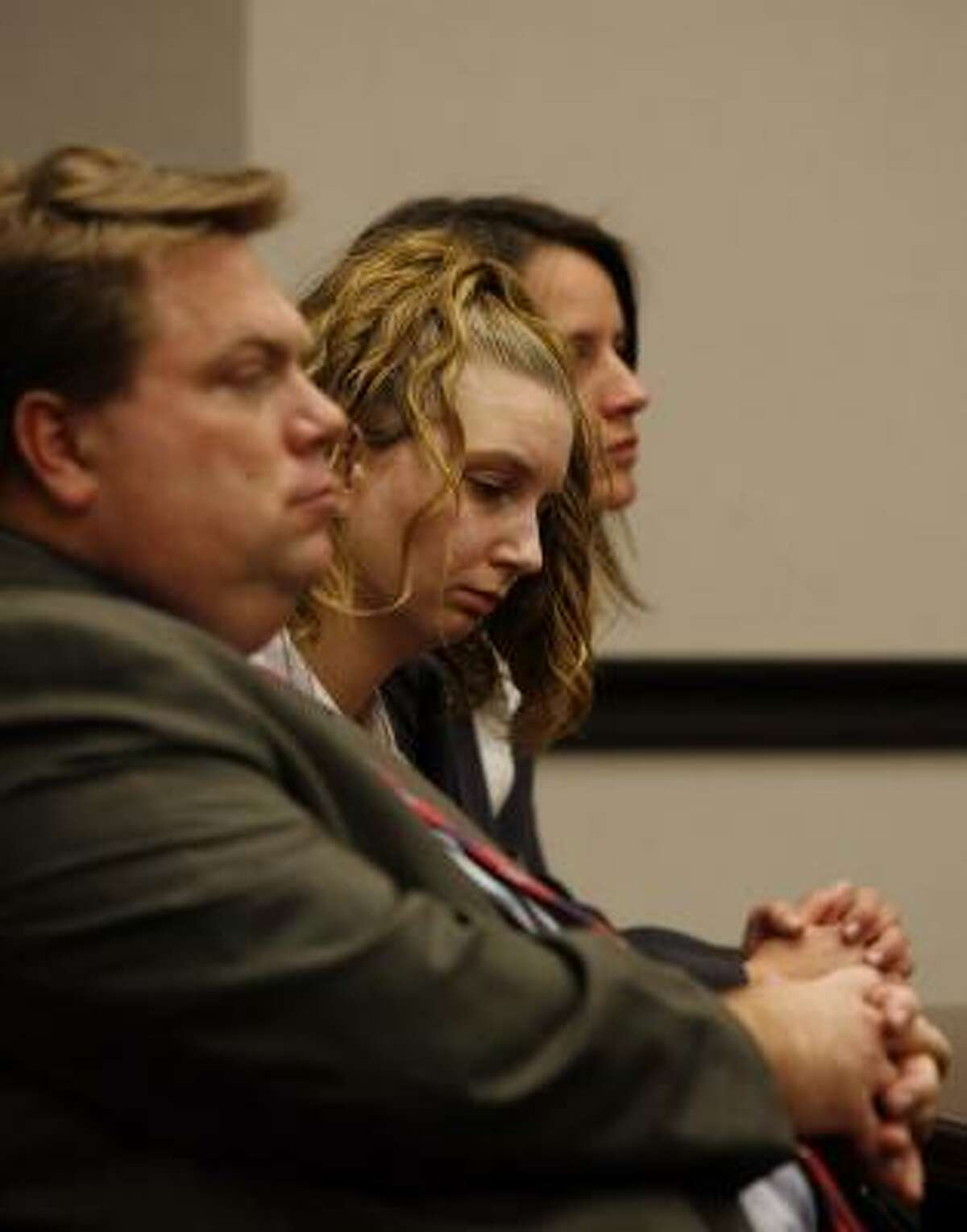 Kimberly Dawn Trenor, center, listens as Judge David Garner polls the jury after they found Trenor guilty of capital murder for the 2007 death of her daughter Riley Ann Sawyers, known as