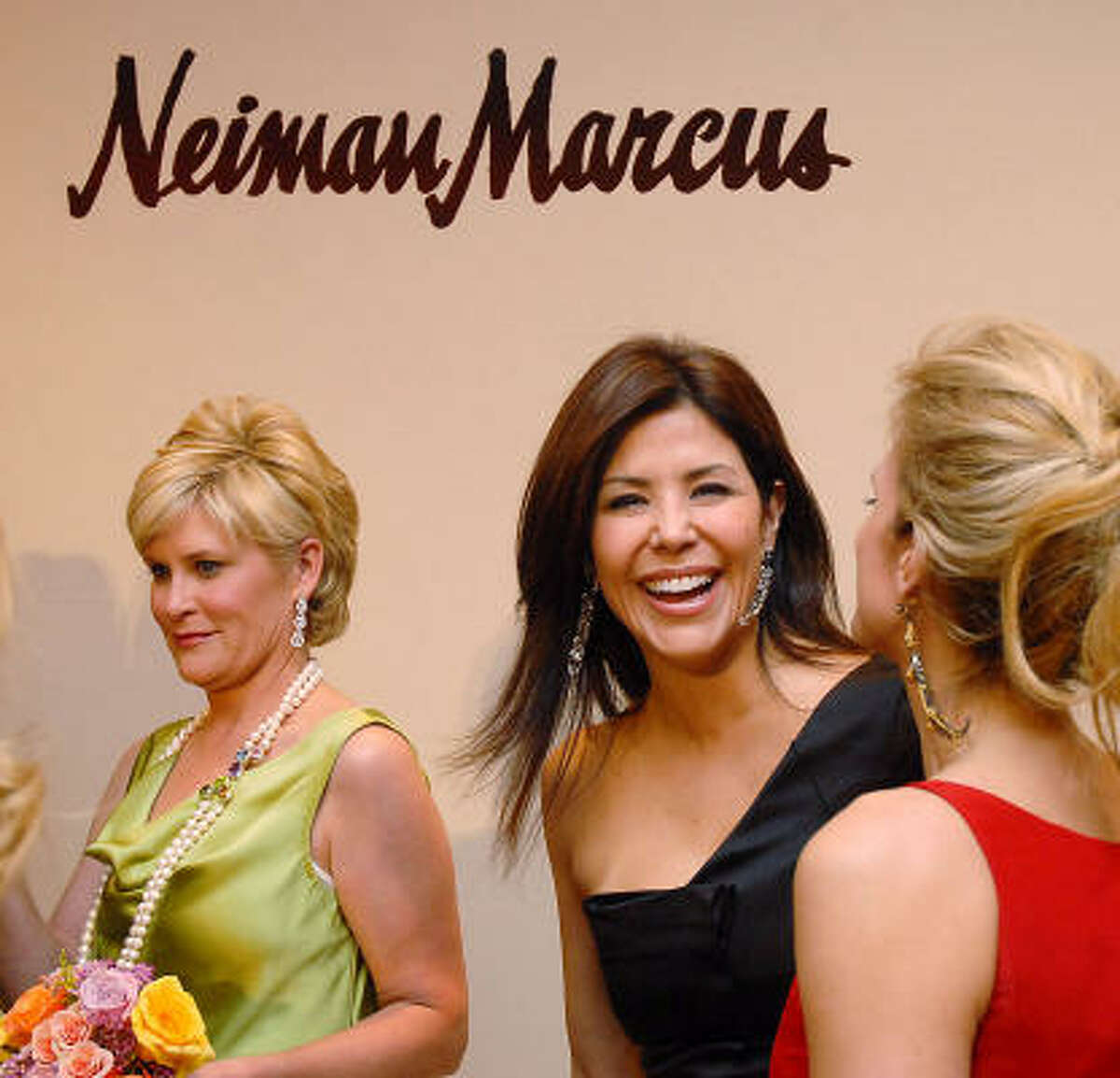 Honorees Ericka Bagwell and Melissa Mithoff share a laugh. At left is honoree Kelli Blanton.
