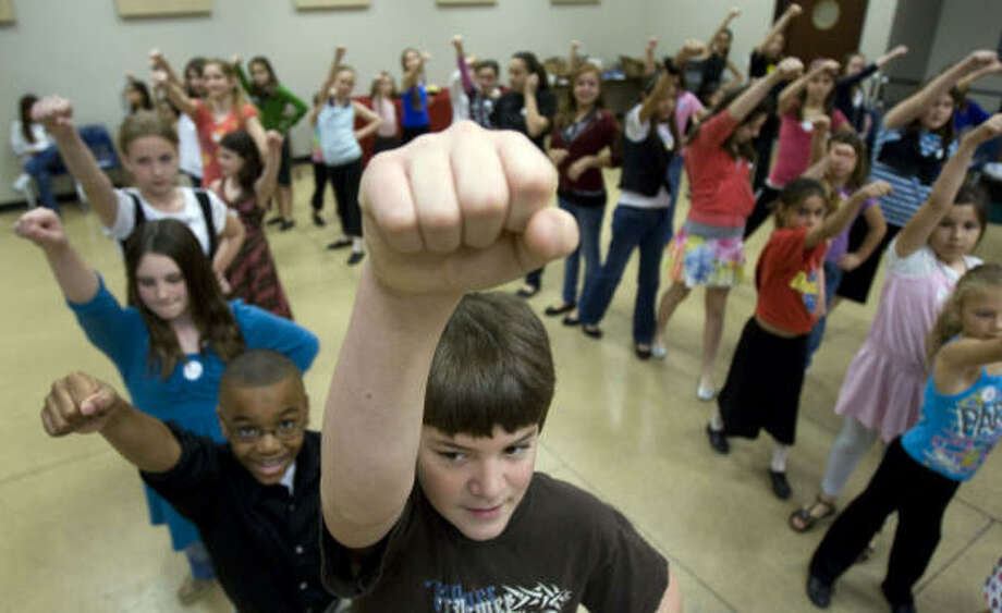 Kids practice for their audition at the Hobby Center for the Performing Arts. Photo: Johnny Hanson, Chronicle