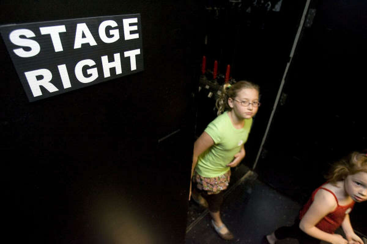 Children leave the stage during the auditions for a performance of the musical based on the classic movie.