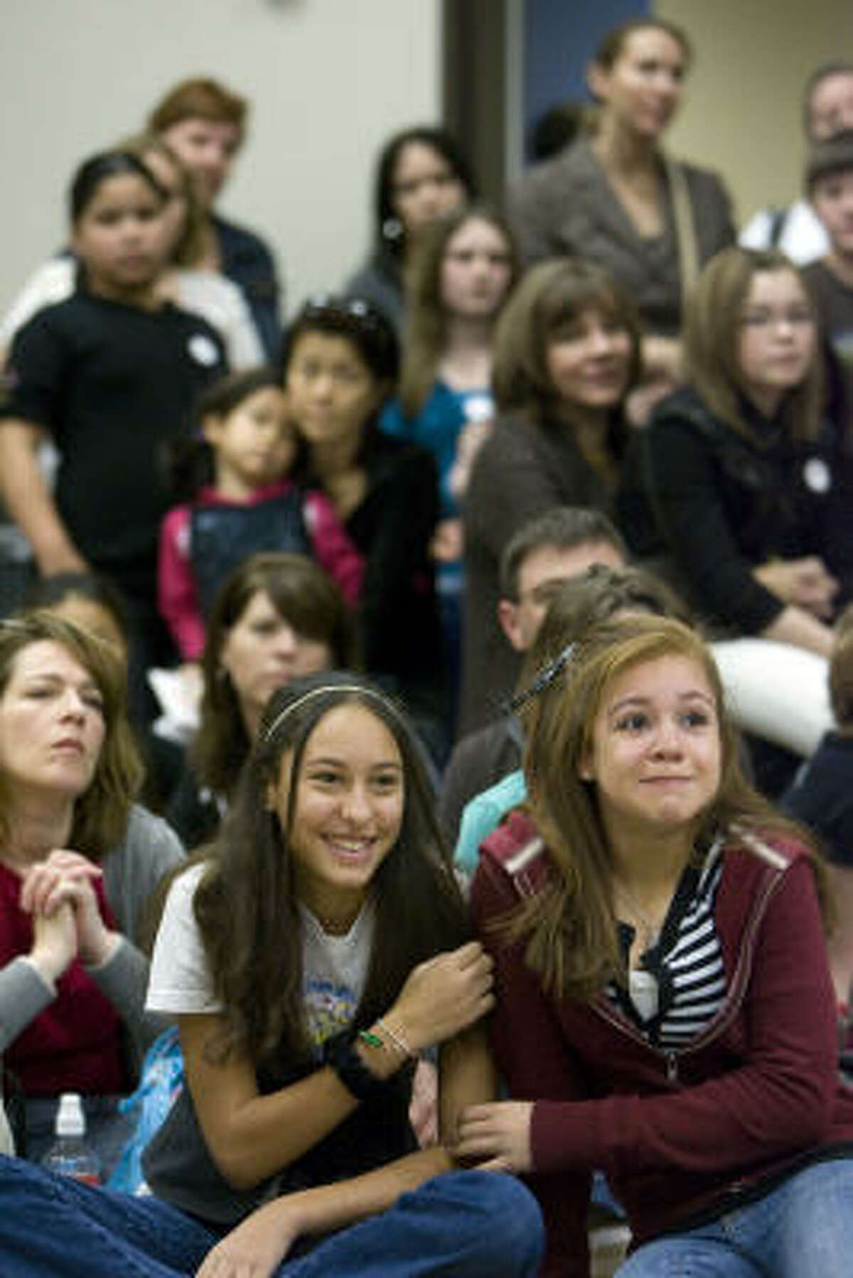 Christa Coleman, 12, left, and Megan Jones, also 12, listen to audition instructions with excitement.