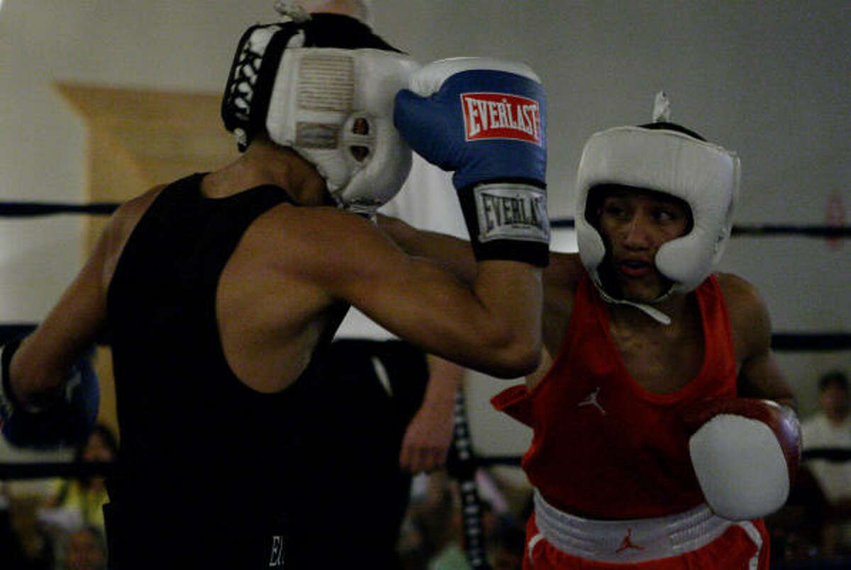Richard Hernandez swings at Daniel Ybarra, right, during the Golden Gloves boxing competition ( open 17 to 34 years old 106 weight ). Ybarra won the match, his fourth consecutive Golden Gloves win.