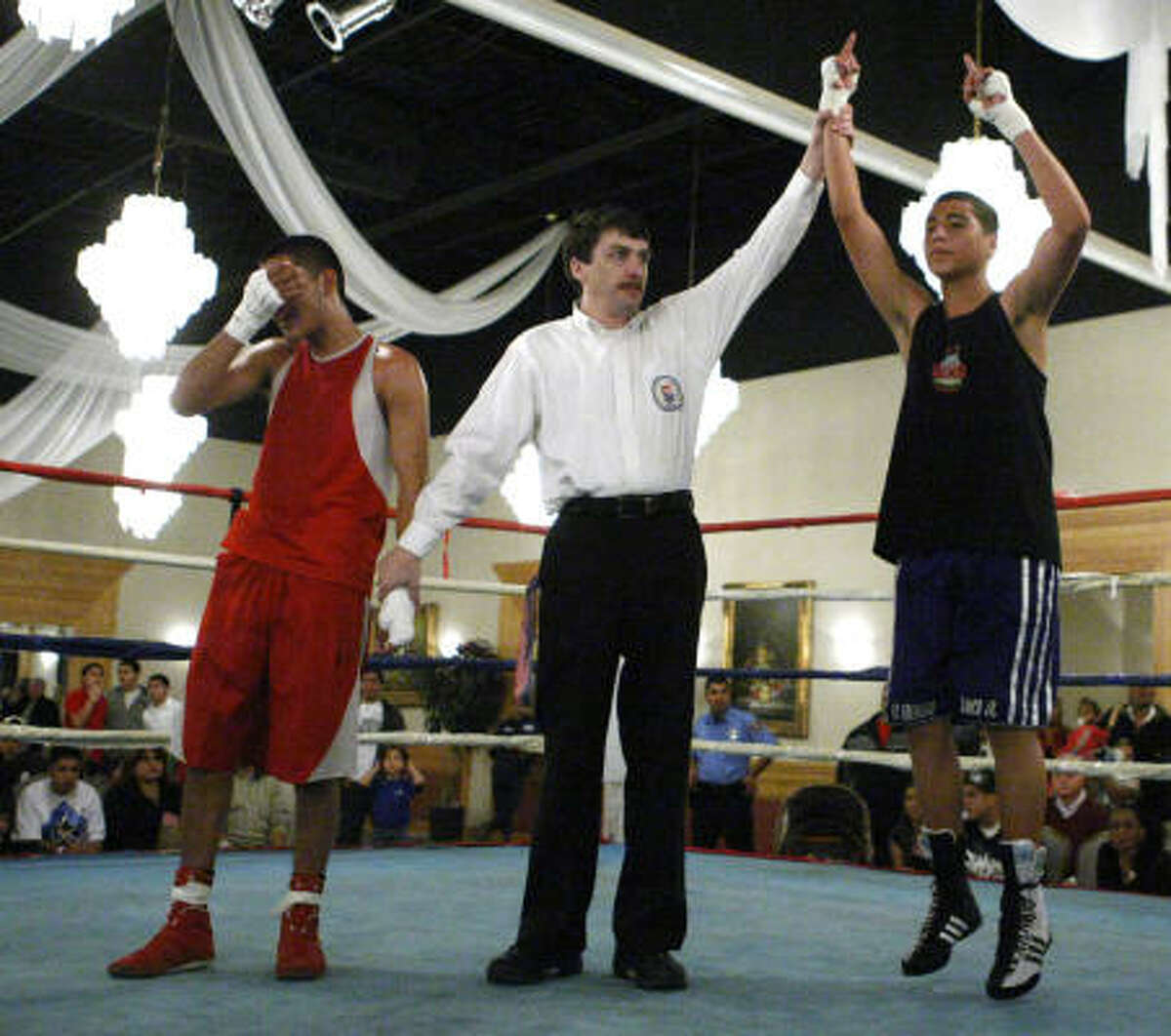 Day 2, Thursday, Jan. 29: Nolberto Blanco of Untimate Warriors reacts as he wins his bout over Antonio Capulin of Screaming Eagles in the 132-pound Junior Olympic Open class during the Southwest Regional Golden Gloves Boxing Tournament.