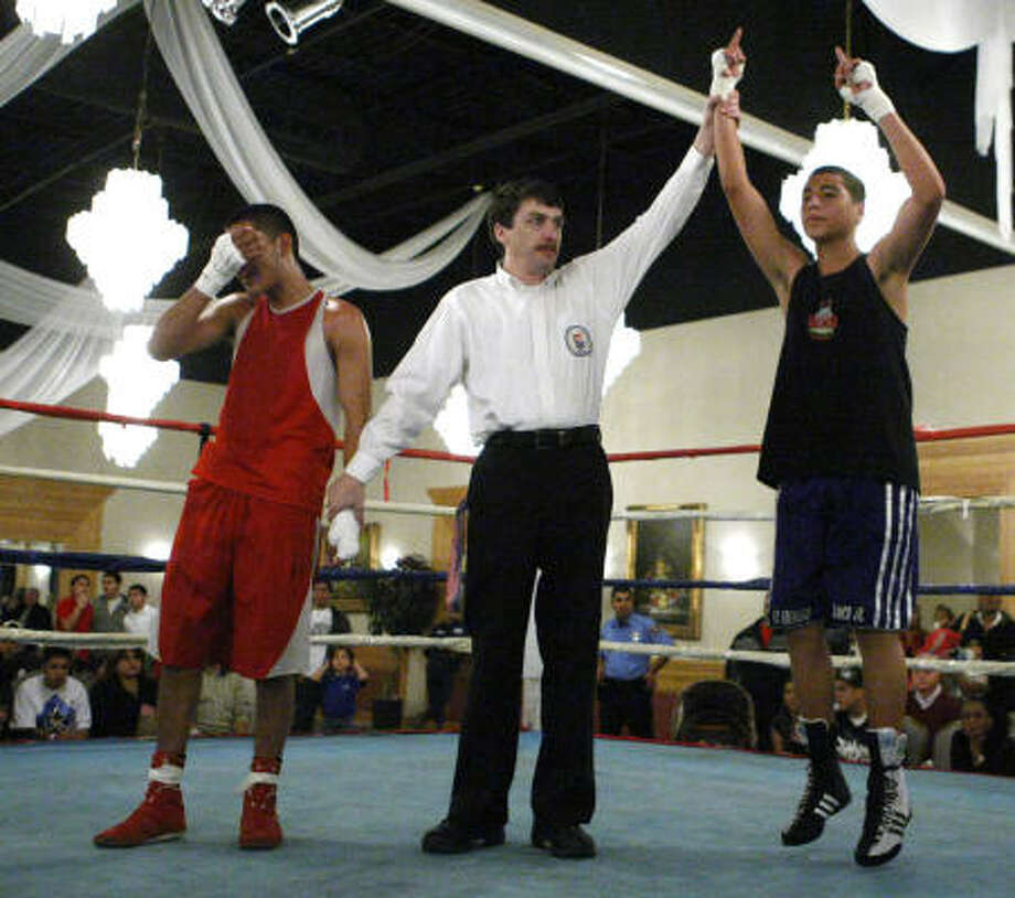 Day 2, Thursday, Jan. 29:Nolberto Blanco of Untimate Warriors reacts as he wins his bout over Antonio Capulin of Screaming Eagles in the 132-pound Junior Olympic Open class during the Southwest Regional Golden Gloves Boxing Tournament. Photo: Brett Coomer, Chronicle