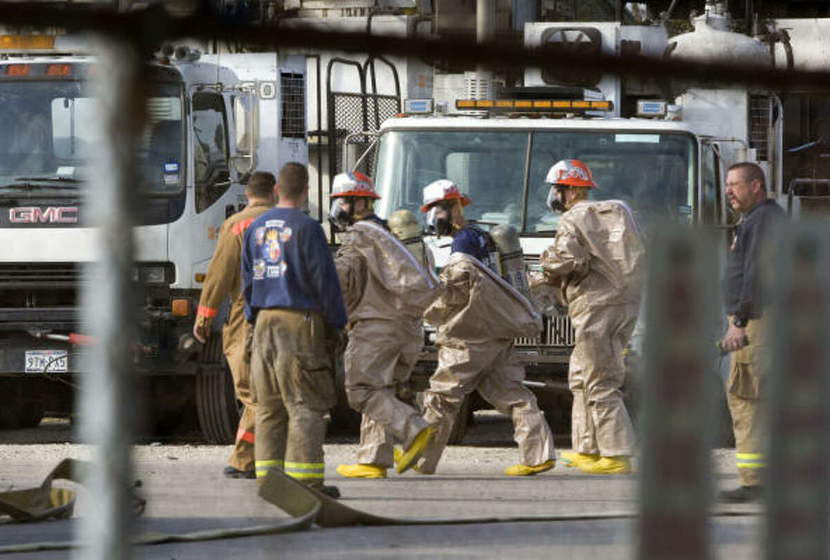 Houston firefighters suit up in chemical protection suits as they prepare to contain the chemical leak.