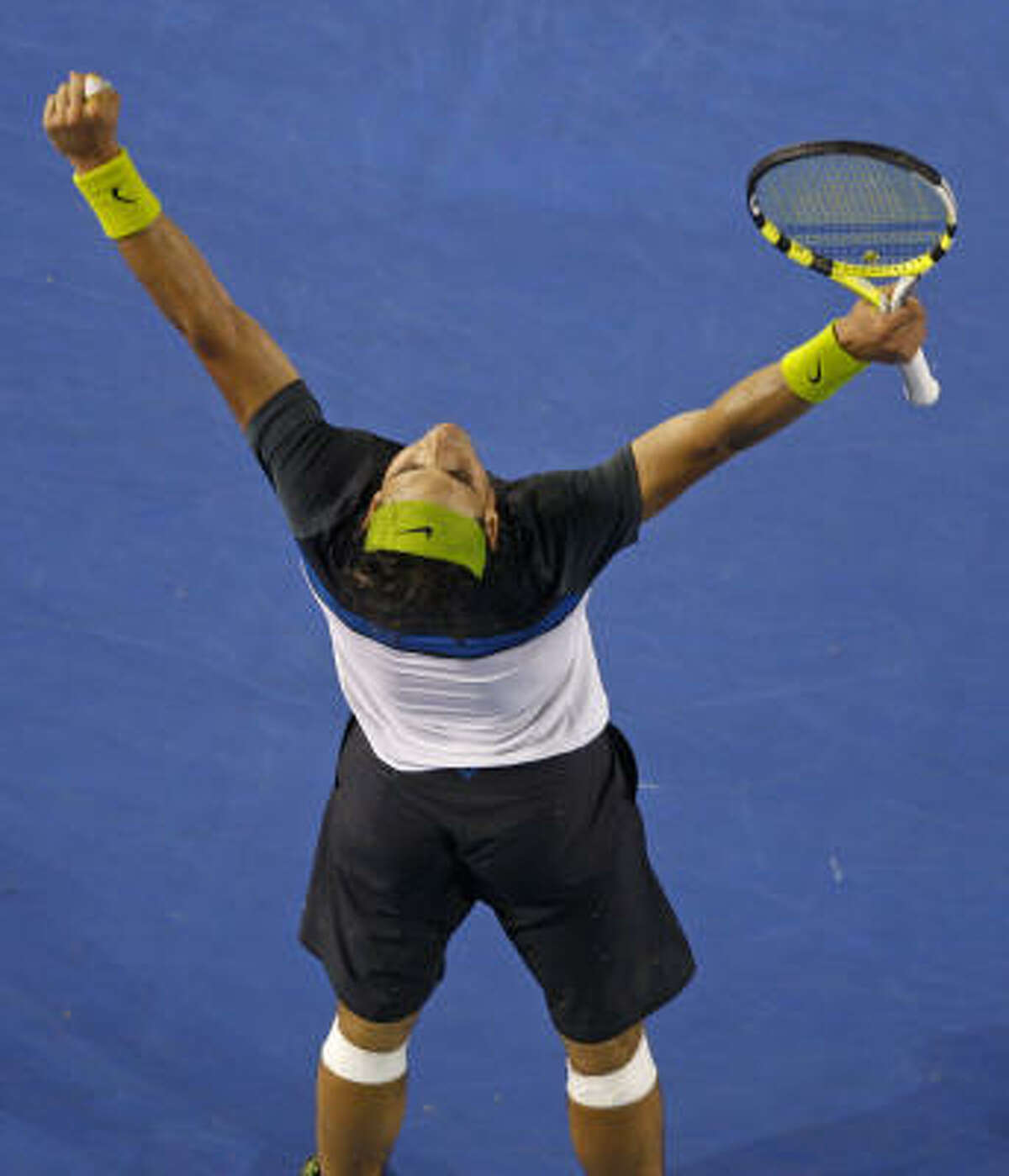 February 1, Rafael Nadal defeats Roger Federer in men's final Rafael Nadal, who has four consecutive titles on clay at Roland Garros and beat Roger Federer on grass in a five-set epic at Wimbledon last year, became the first Spaniard to win the Australian title.
