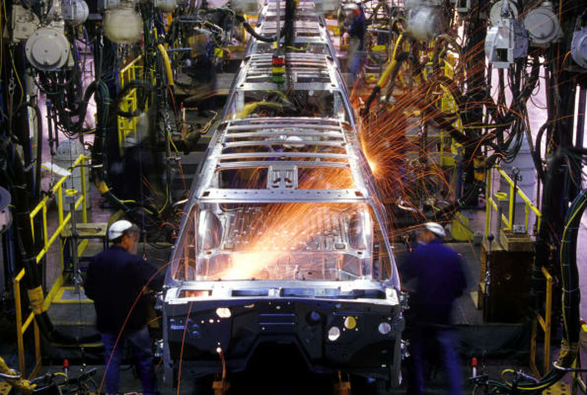 Spot welding SUV bodies on an assembly line at the Chevrolet Suburban plant in Silao, Guanajuato, Mexico.