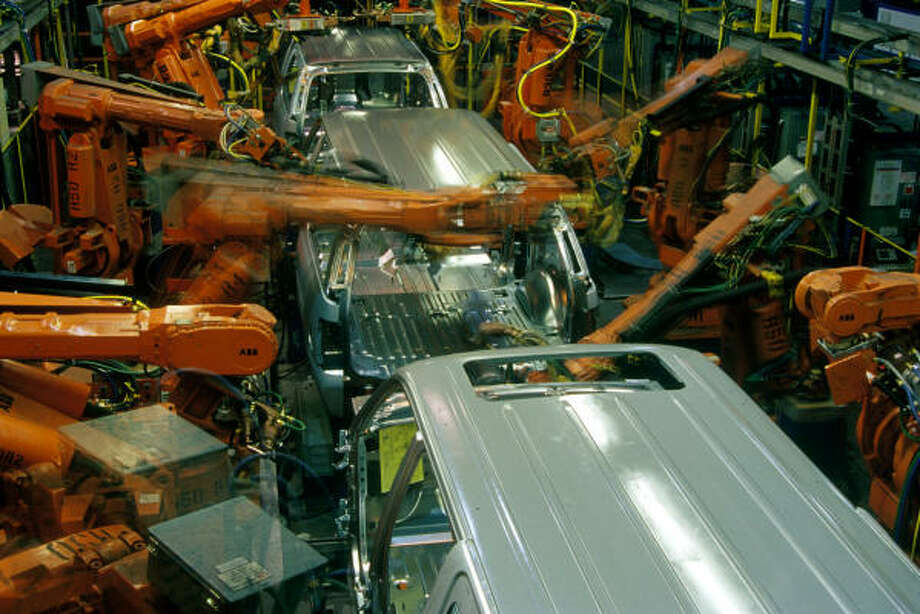 Robots weld SUV bodies on an assembly line at the Chevrolet Suburban plant in Silao,Guanajuato,Mexico. Photo: Keith Dannemiller