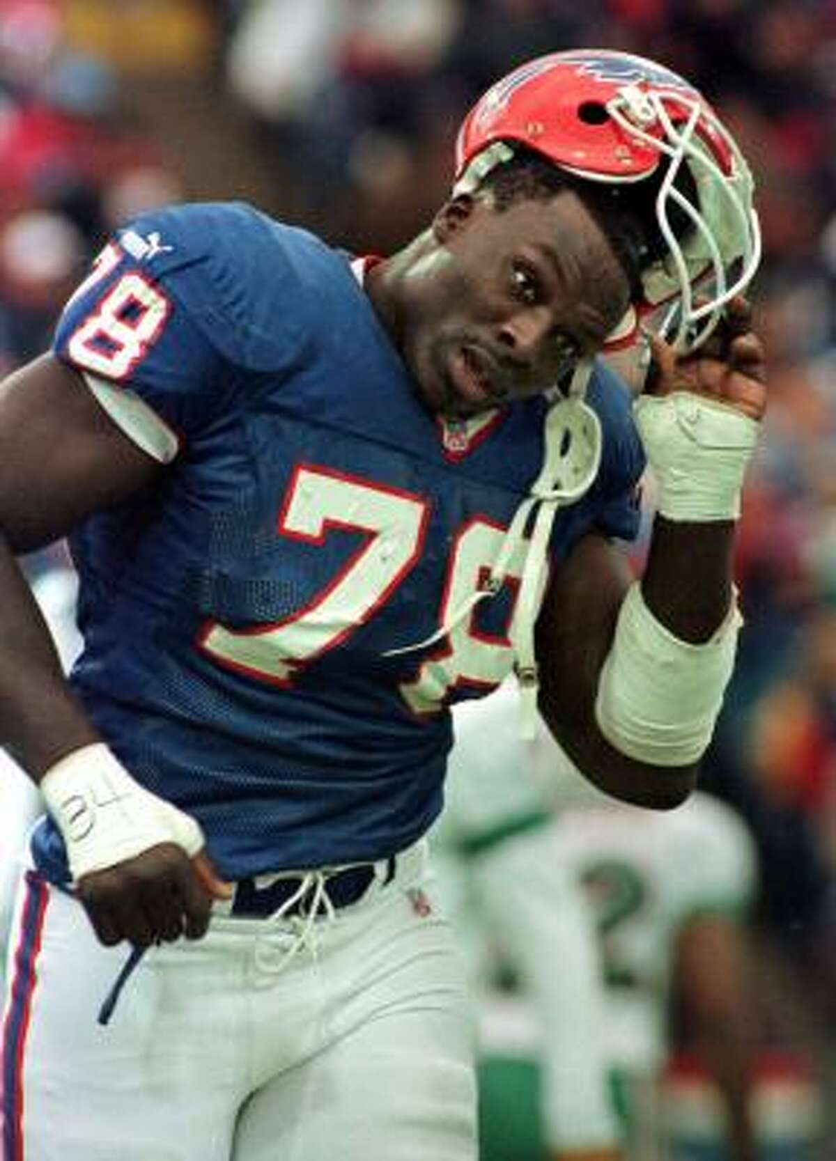 Bruce Smith - Defensive End - 1985-1999 Buffalo Bills, 2000-03 Washington Redskins. Smith was drafted No. 1 overall in 1985 and is the all-time sacks leader with 200.