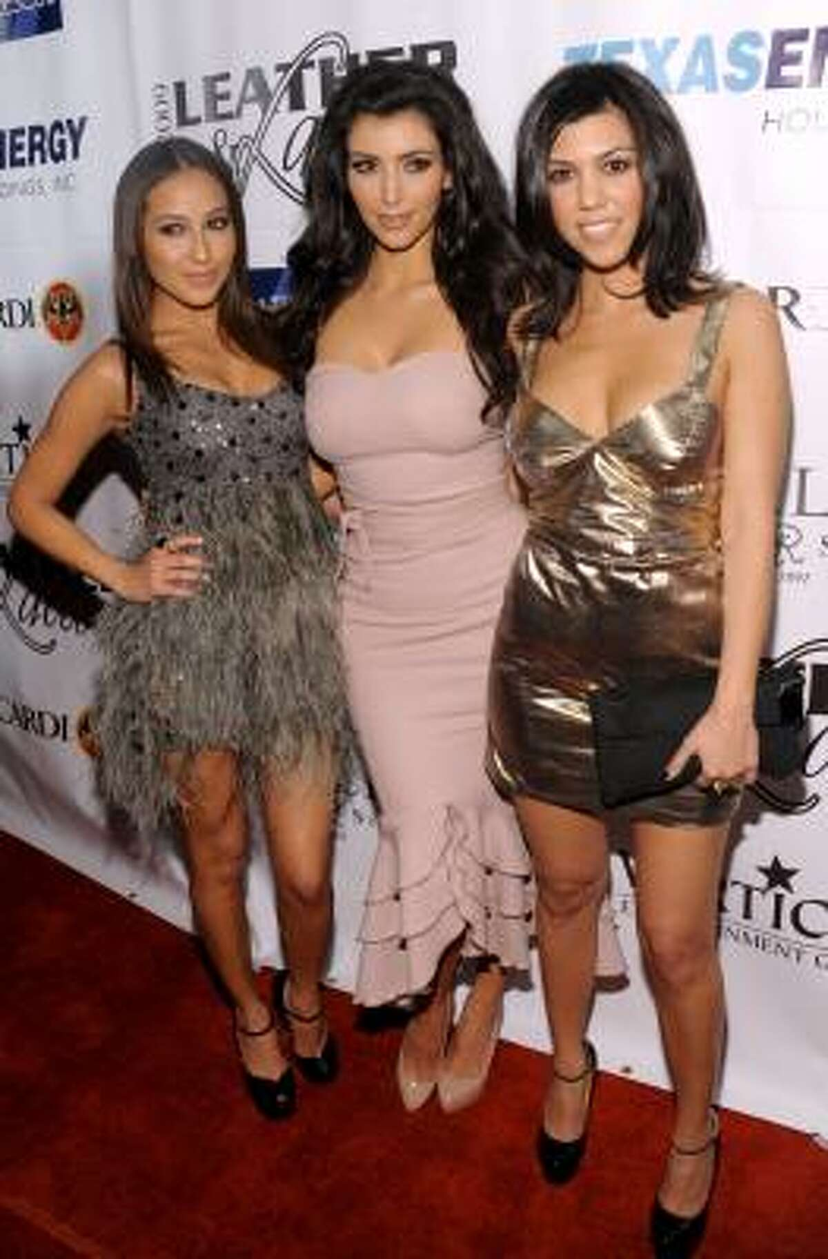Adrienne Bailon, left, party co-host Kim Kardashian and Kourtney Kardashian arrive at the 6th Annual Leather and Laces Super Bowl Celebration at Jacksonís, Friday in Tampa.