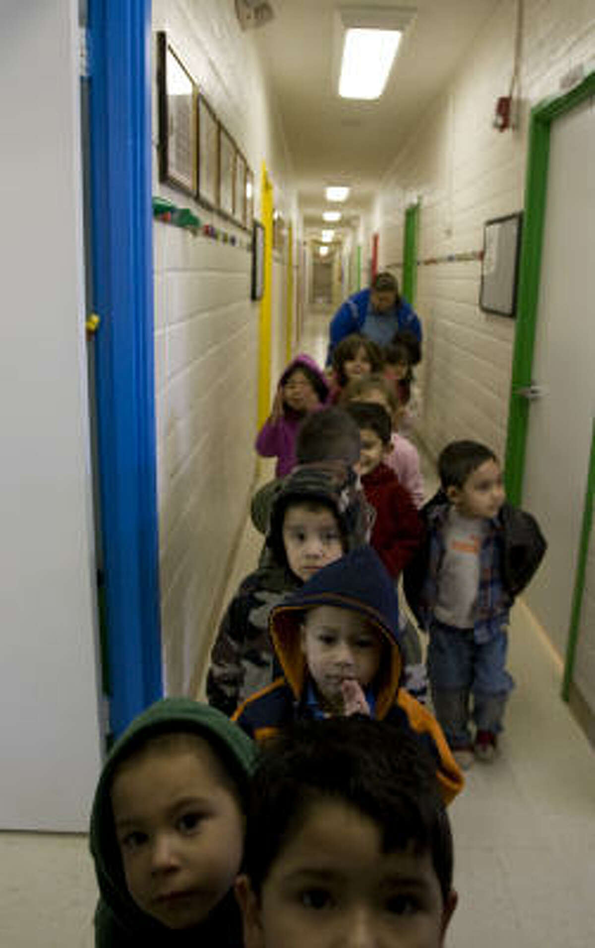 Children get ready for playground time. Day-care revenue at the YMCA is down an estimated 10 percent.