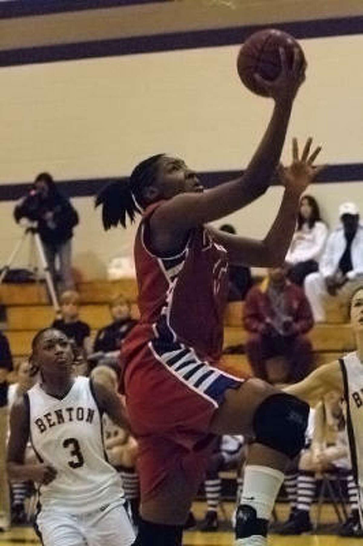 Jan. 30, 2007 Sophomore Kelsey Bone drives against Benton, La., High. in the Katy Invitational Basketball Tournament at Morton Ranch High School. Bone's Dulles squad defeated Benton, 89-51.