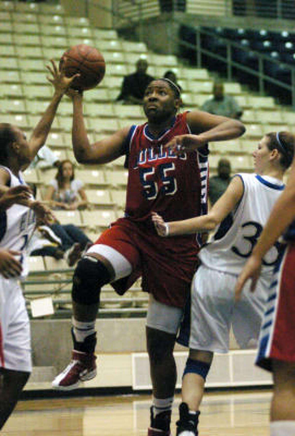 Nov. 13, 2007 Dulles' Kelsey Bone drives to the basket against Elkins.