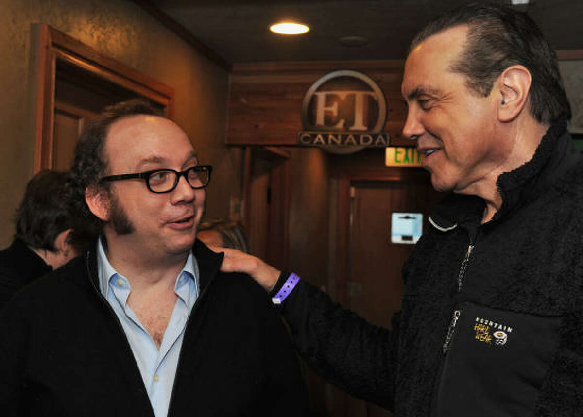 Actors Paul Giamatti, left and Chazz Palminteri at the Gibson Guitar Lounge during the Sundance Film Festival in Park City, Utah, on Jan. 19