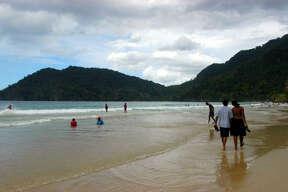 A romantic stroll on Maracas Beach in Trinidad.