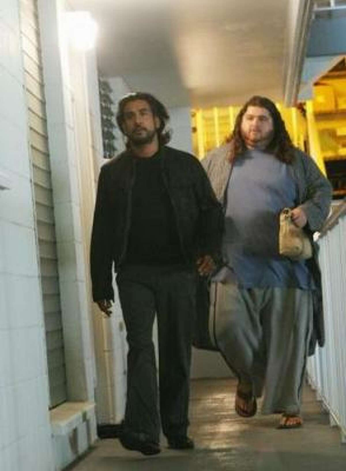 Sayid and Hurley team up after the big guy's exit from the mental hospital. Yummy fries!